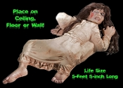 Scary Carrie needs an exorcism! Life Size Latex Possessed girl prop. Don't turn your back on this ankle bitter! Hang on wall, ceiling, or lay on floor or bed. Light, highly durable, weather resistant. Flat backed for haunted house placement anywhere!