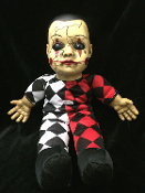 Creepy harlequin HELLEQUIN HAUNTED DOLL with SOUND has a spooky face, black eyes and fake cracks for a ghostly look. Scary gothic toy monster talking dolly Halloween haunted house prop decoration. Innocent childlike voice speaks with eerie music.