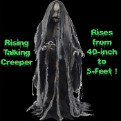 Life Size Deluxe Animated Creeper Rising Talking Zombie Character has moving mouth and light-up eyes, a tattered costume. The prop starts at a 40-inch height and rises to a full 60-inch. Step Here pad.