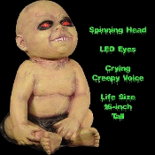Creepy Life Size Latex Animated Possessed Baby Doll with Spinning Head and LED Eyes. Halloween haunted house horror prop decoration. 16-inch tall with motion detector. Scary monster baby head spins all the way around with crying baby voice sounds.